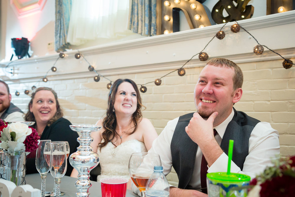 heritage-hall-missoula-montana-groom-laughing-during-toast.jpg