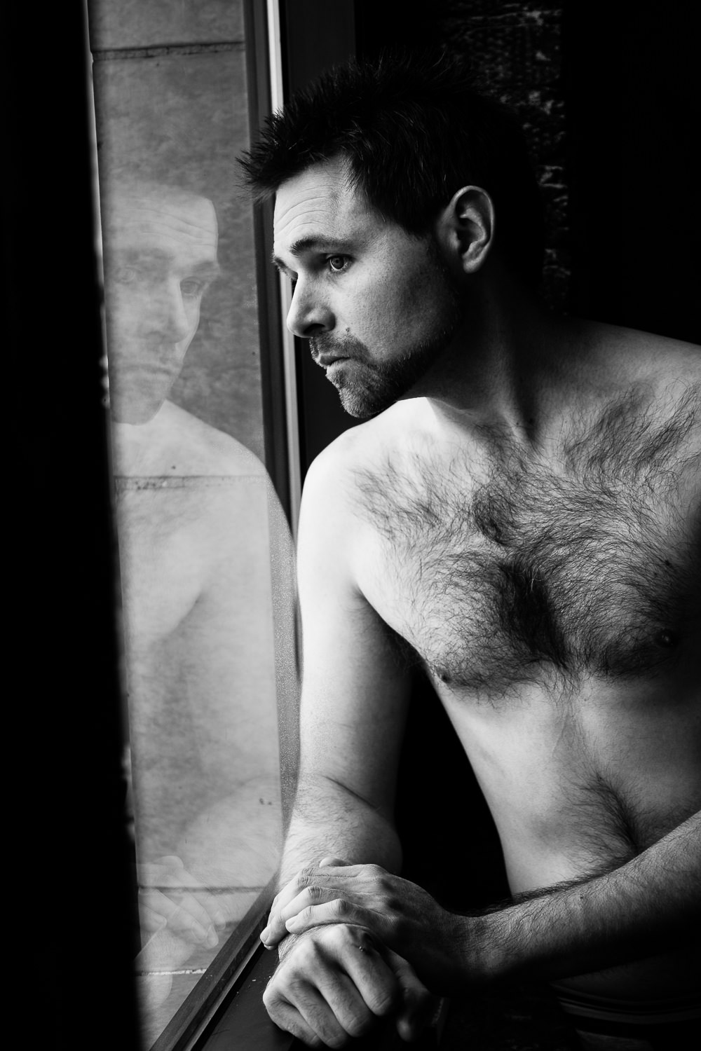 billings-montana-boudoir-man-window-reflection.jpg