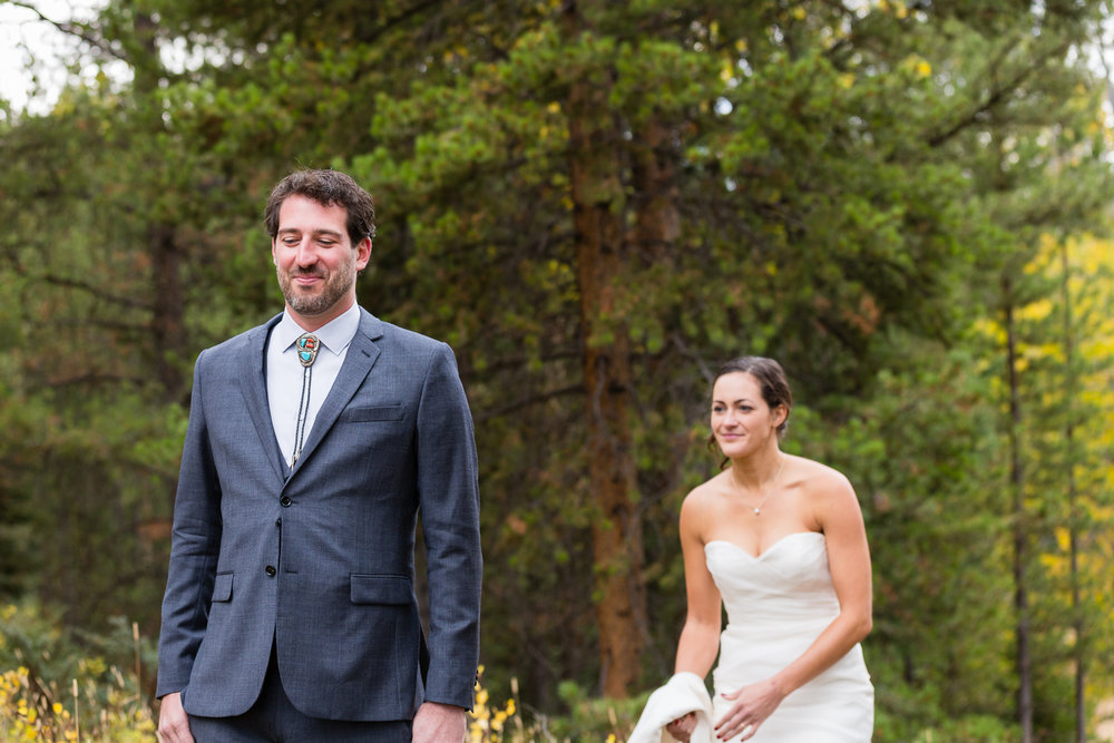 big-sky-montana-gallatin-riverhouse-wedding-bride-sneaks-up-on-groom.jpg