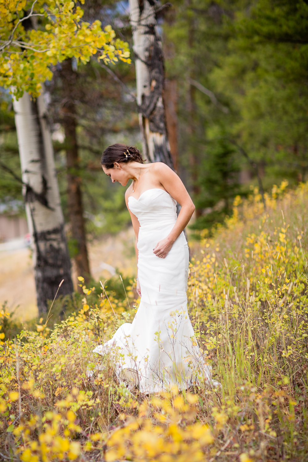 big-sky-montana-gallatin-riverhouse-wedding-bride-picks-up-back-of-dress.jpg