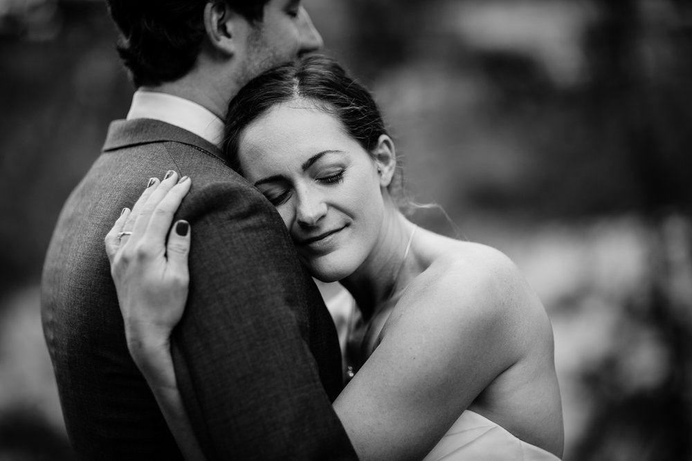 big-sky-montana-gallatin-riverhouse-wedding-bride-hugs-groom.jpg