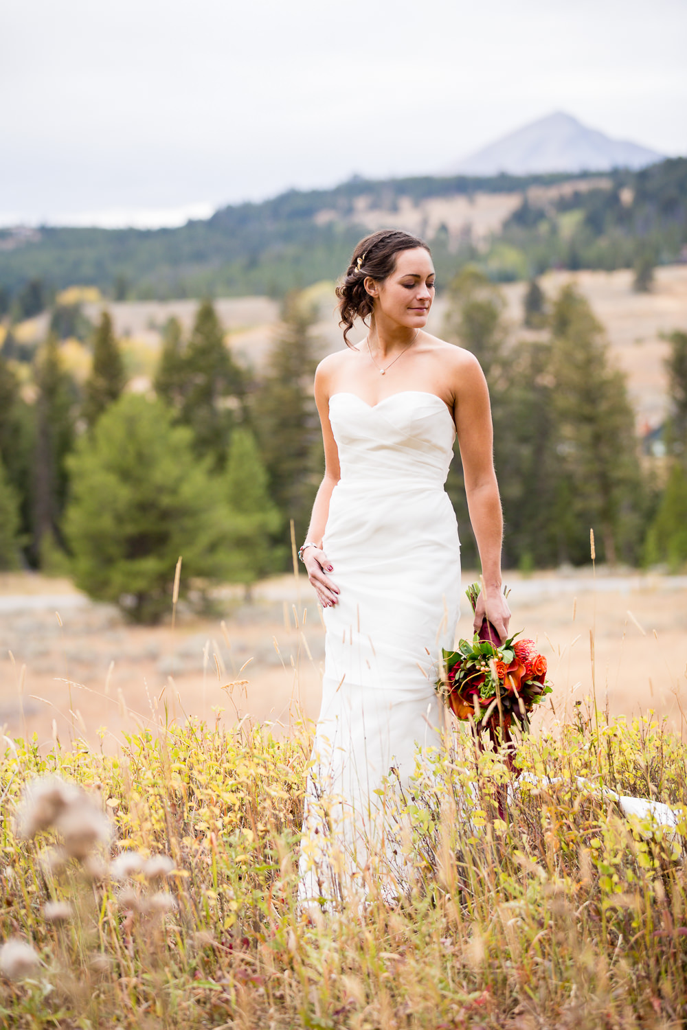 big-sky-montana-gallatin-riverhouse-wedding-bride-shows-off-dress-bouquet.jpg