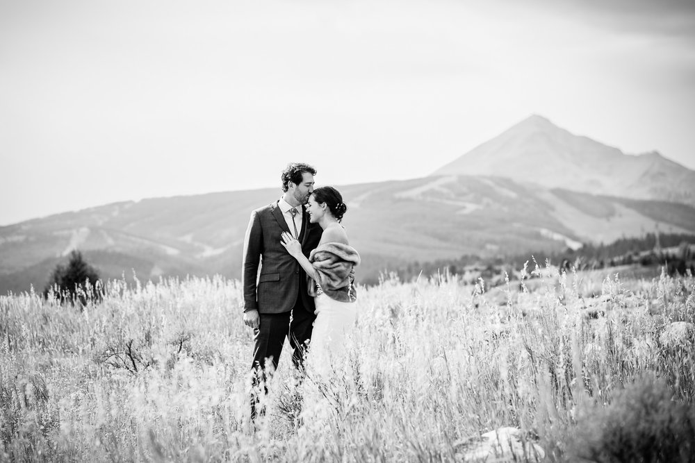 big-sky-montana-gallatin-riverhouse-wedding-groom-kisses-brides-forehead.jpg