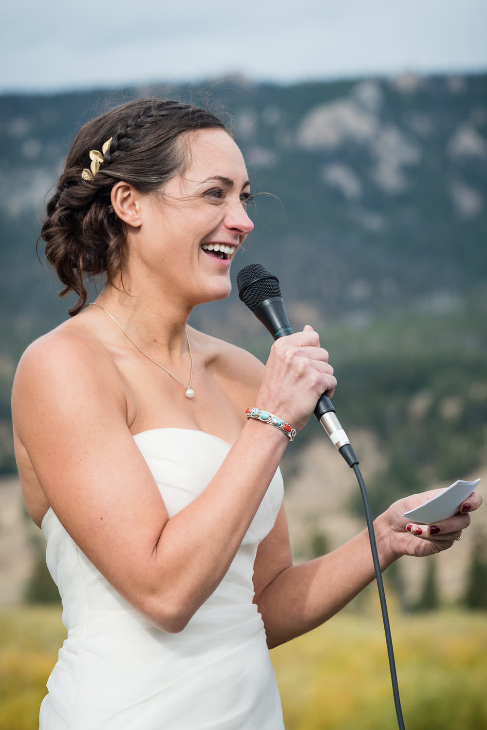 big-sky-montana-gallatin-riverhouse-wedding-bride-laughs-during-vows.jpg
