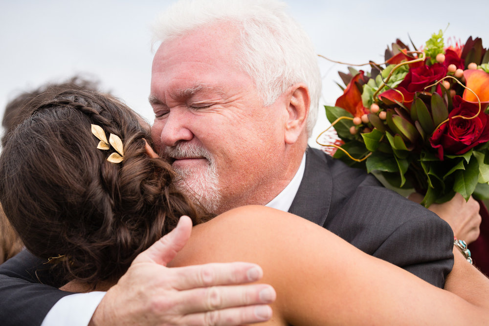 big-sky-montana-gallatin-riverhouse-wedding-dad-hugs-bride.jpg