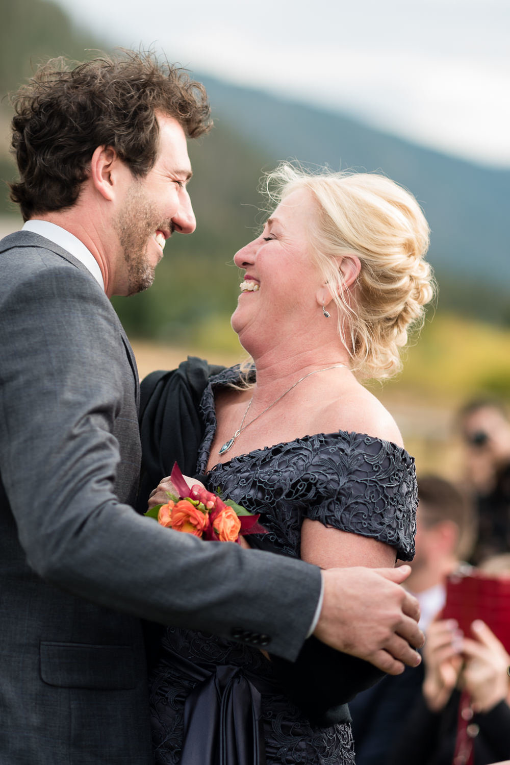 big-sky-montana-gallatin-riverhouse-wedding-groom-hugs-mom-before-ceremony.jpg