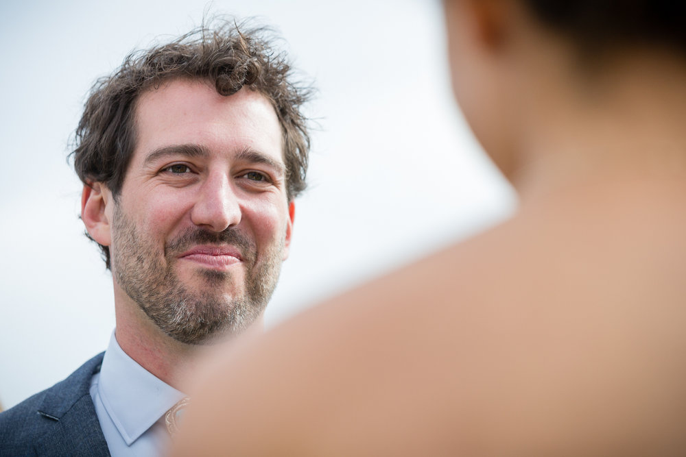 big-sky-montana-gallatin-riverhouse-wedding-groom-during-vows.jpg