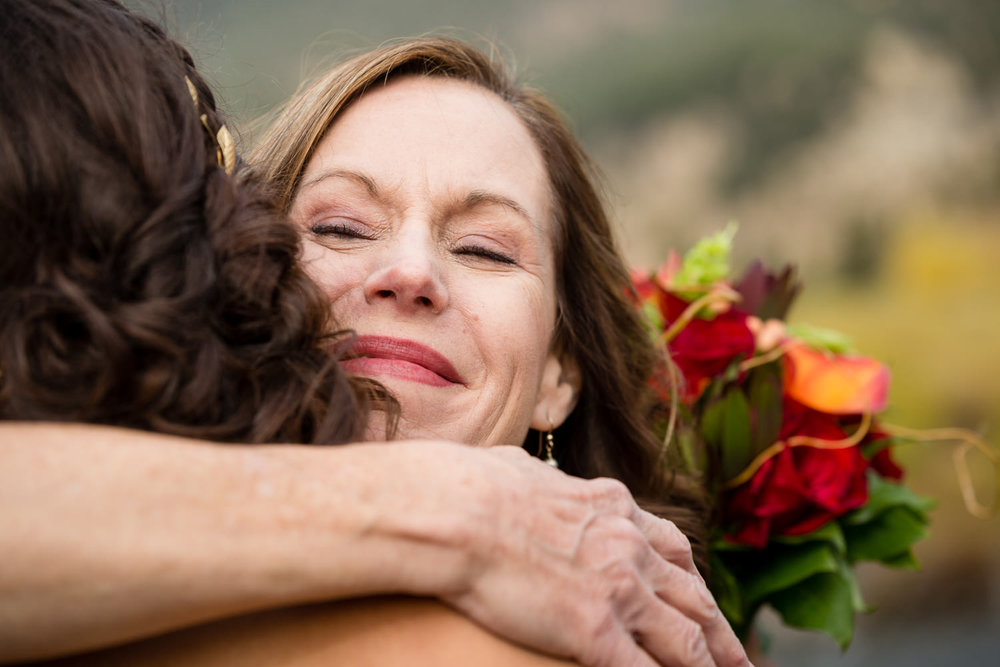 big-sky-montana-gallatin-riverhouse-wedding-mom-hugs-bride.jpg
