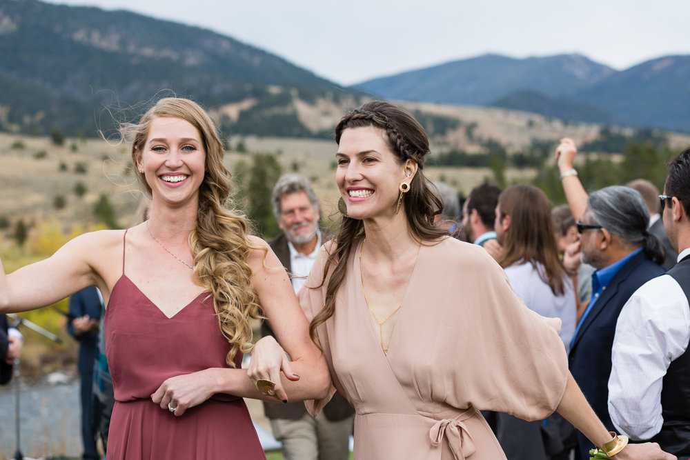 big-sky-montana-gallatin-riverhouse-wedding-grooms-sisters-during-recessional.jpg