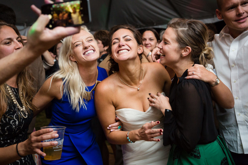 big-sky-montana-gallatin-riverhouse-wedding-bride-friends-posing-during-dance.jpg