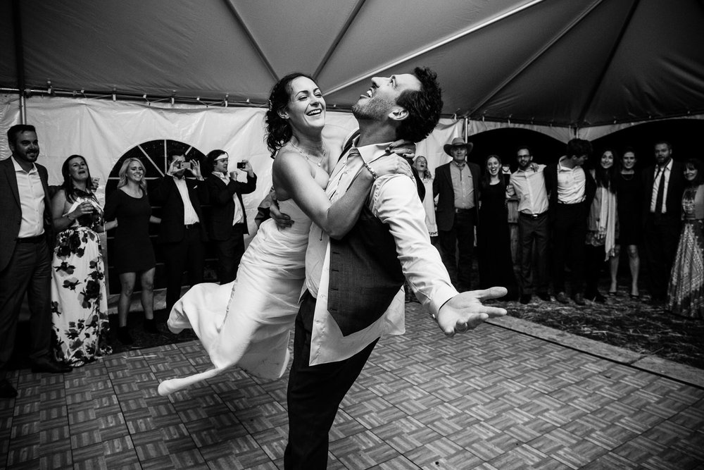 big-sky-montana-gallatin-riverhouse-wedding-groom-lifts-twirls-bride-across-dance-floor.jpg