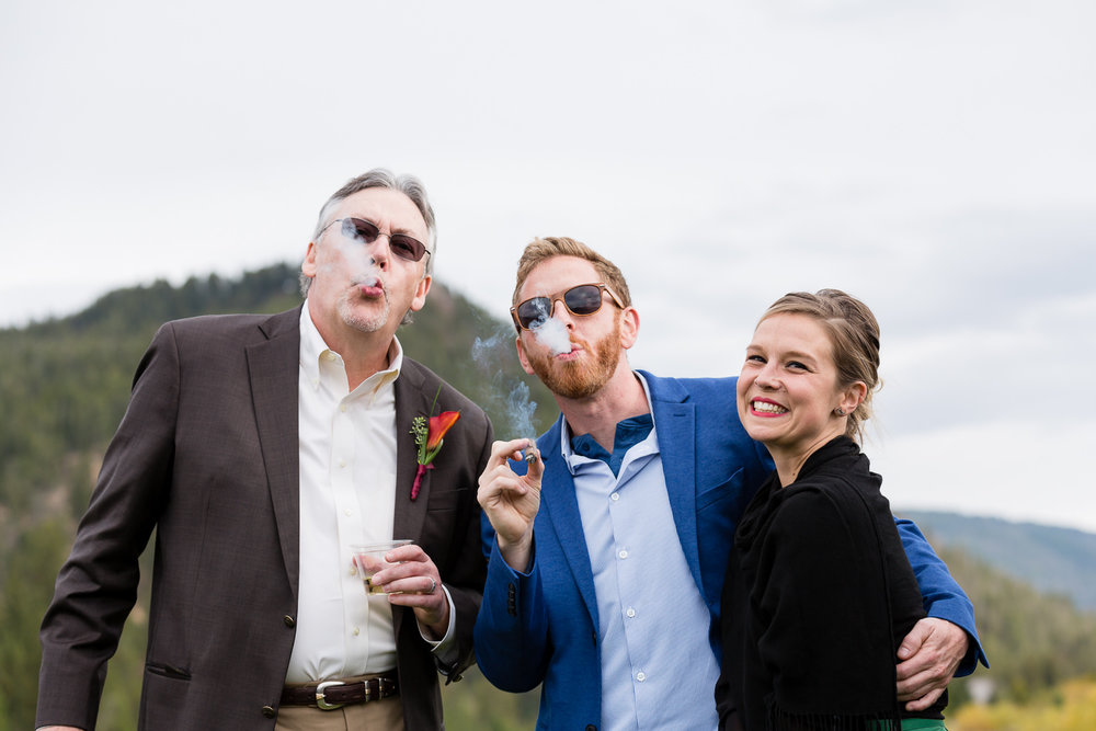 big-sky-montana-gallatin-riverhouse-wedding-guests-smoking-cigars.jpg