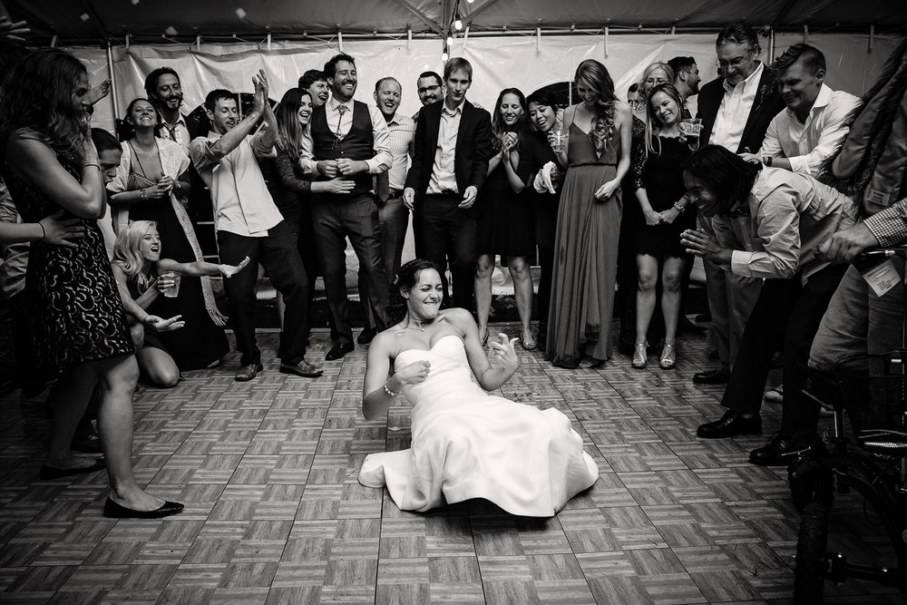 big-sky-montana-wedding-reception-bride-playing-air-guitar.jpg