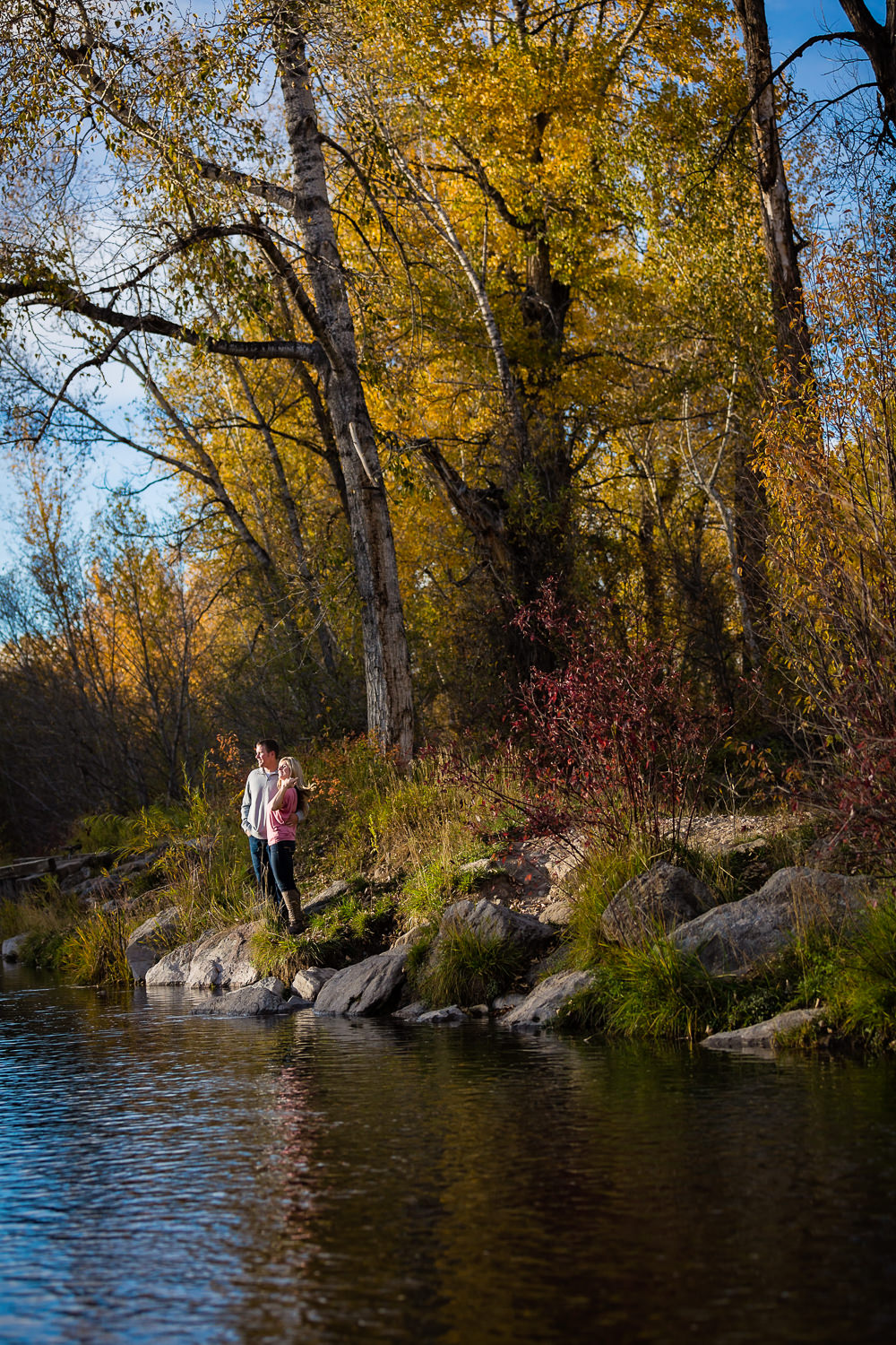 bozeman-montana-engagement-session-couple-by-pond.jpg
