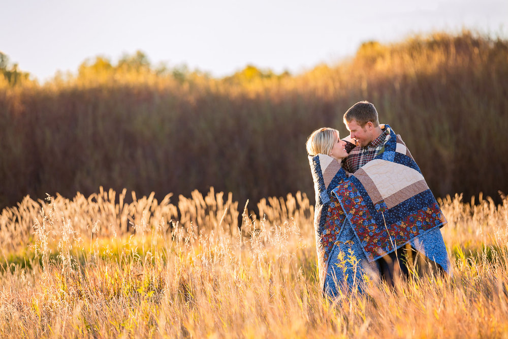 bozeman-montana-engagement-session-fall-season-couple-wrapped-in-blanket.jpg