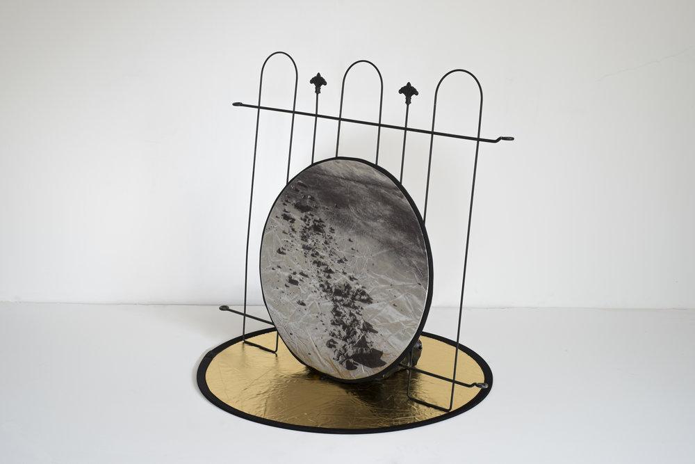 "Theo Mullen,  o ~ € ~ o , metal fence, reflector, UV print, plaster, 36"" x 30"" x 36"" 2015"