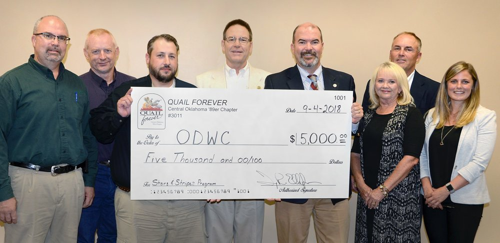 Central Oklahoma Quail Forever donated $5,000 to the ODWC Stars & Stripes License Project to buy hunting and fishing licenses for military in Oklahoma. Funds were generated during the chapter's 13th Annual fundraising banquet August 18, 2018.