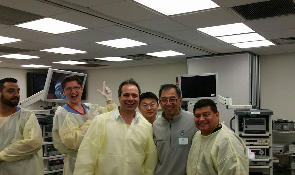 Dr. Loredo and Romi Mirza training a very talented group of Hand Surgery Fellows.