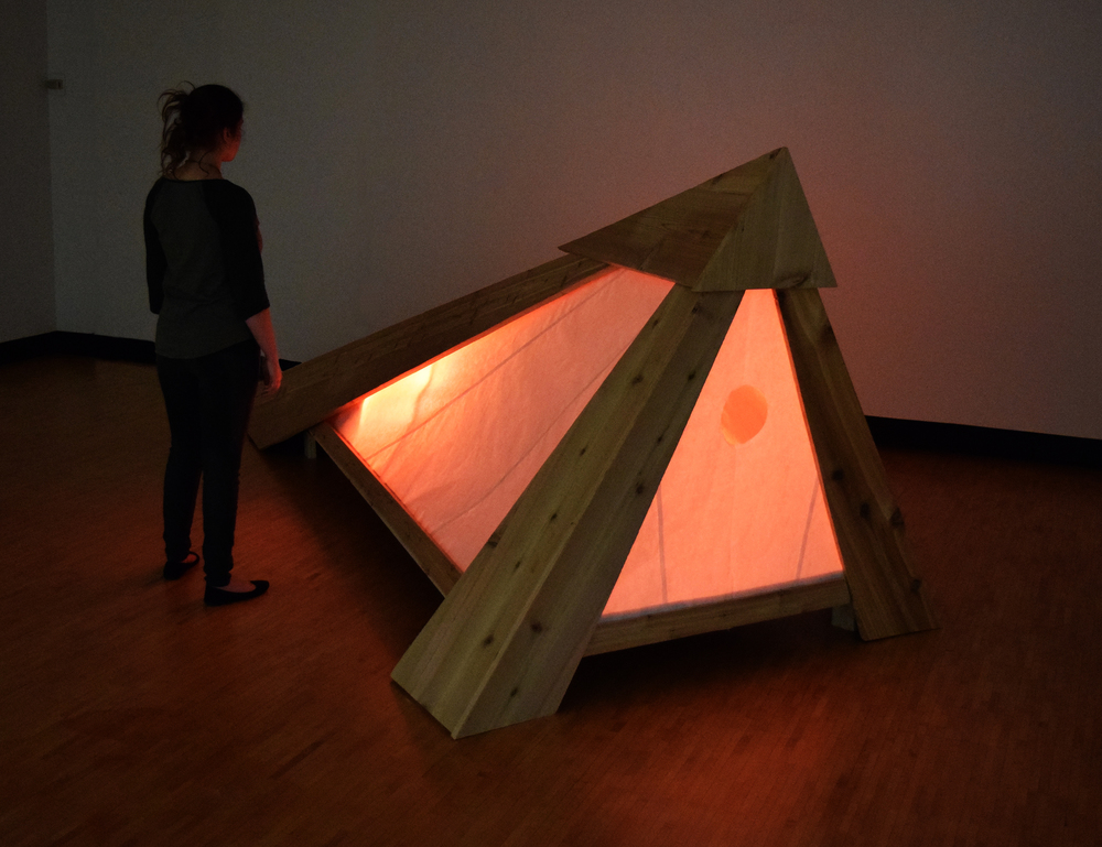 Anchorhold, mixed media: cedar, plywood, kozo mulberry paper, led light cycle (fabricator CJ Boyle