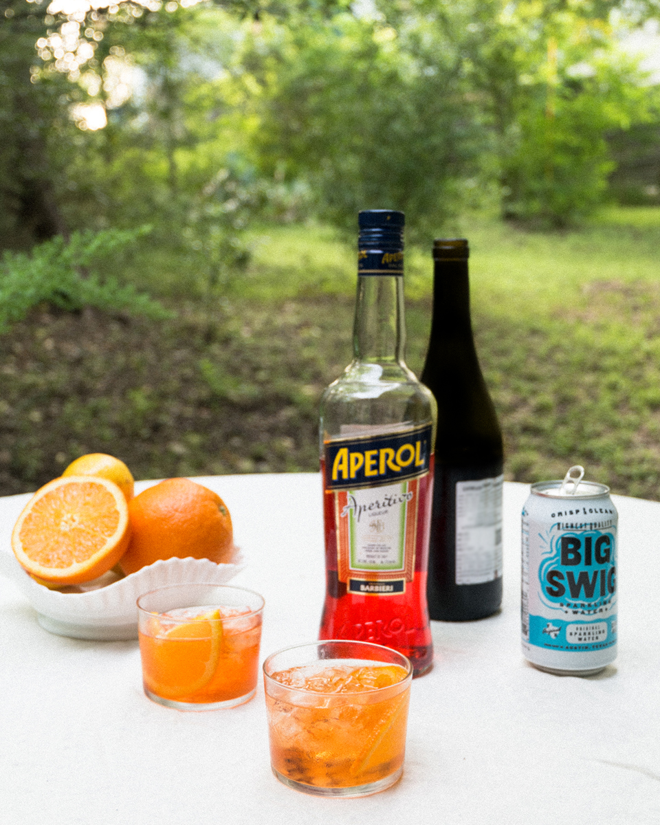 - FELIZ Spring 2018 is May 6th 11-6pm, and we'll be serving Aperol Spritzes made with local sparkling water, Big Swig!Swing by the Palm Door on Sabine to see some of our favorite designers, sip on a drink and have a relaxing Sunday.