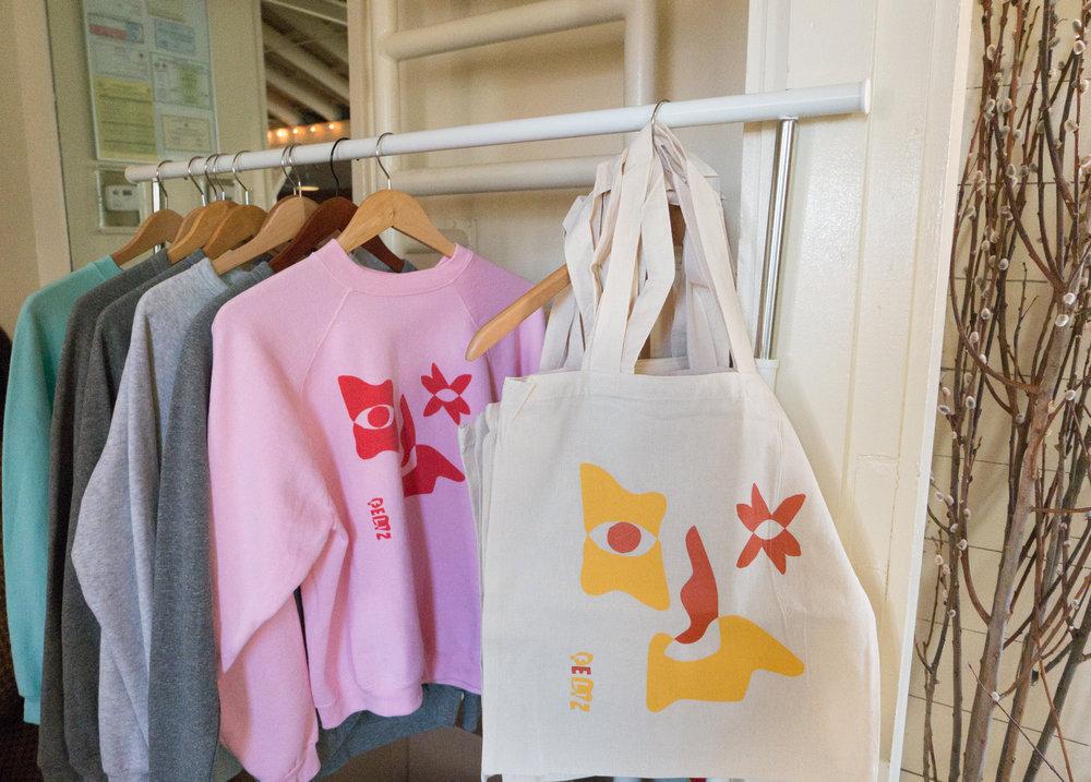 FELIZ sweatshirts and totes designed by  Hallie Brewer