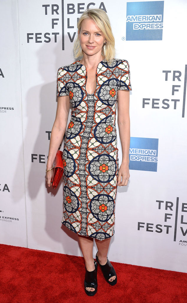 NAOMI WATTS At the Sunlight Jr. New York premiere, the blond star dazzles in a geometric printed midi dress by Alexander McQueen. Her black open-toe platforms, quaint red clutch and Monique Péan earrings complete her look.