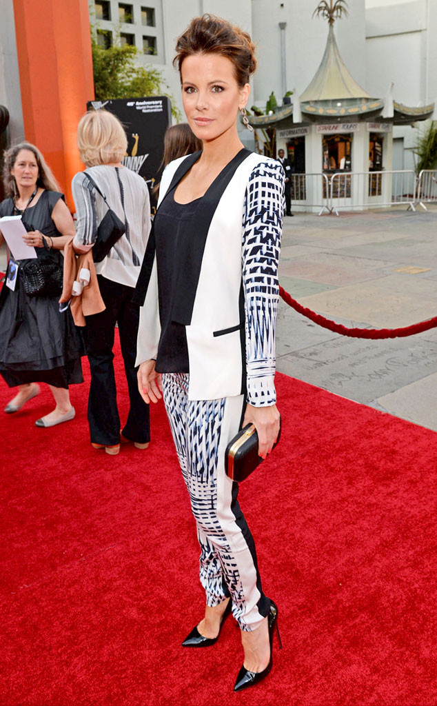 KATE BECKINSALE Rocking the black-and-white trend, the gorgeous actress pairs her patterned Parker suit with a Me Char clutch and patent leather pumps at the Funny Girl Los Angeles screening.