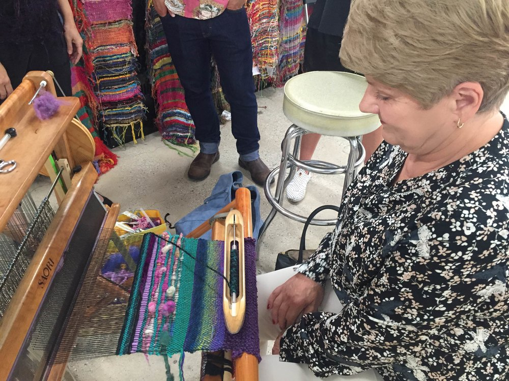 Visitor from Poland weaving on a SAORI loom for the first time! Thank you for coming!