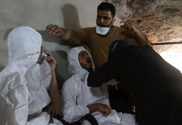 Two men in Syria receive treatment after the suspected chemical weapon attack. Photograph: Ammar Abdullah/Reuters