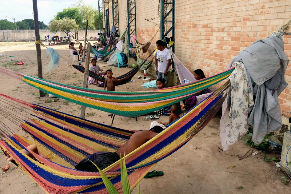 Venezuelans sleep in hammocks outside a shelter in Brazil, while others sleep on the floor inside. February 11, 2017.   © 2017 César Muñoz Acebes/Human Rights Watch