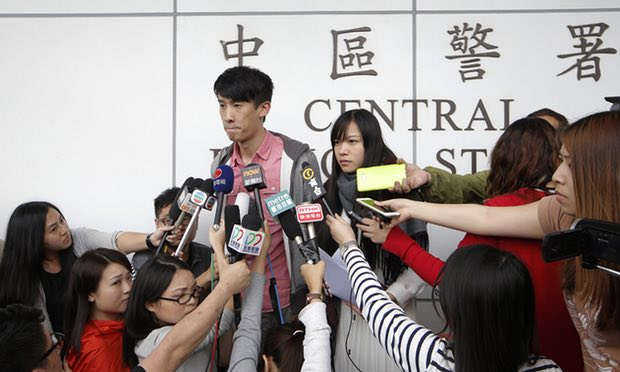 Pro-independence lawmakers Sixtus Leung and Yau Wai-ching speak to the media outside a police station in Hong Kong on Wednesday. Nine other democracy activists have now been arrested. Photograph: Kin Cheung/AP