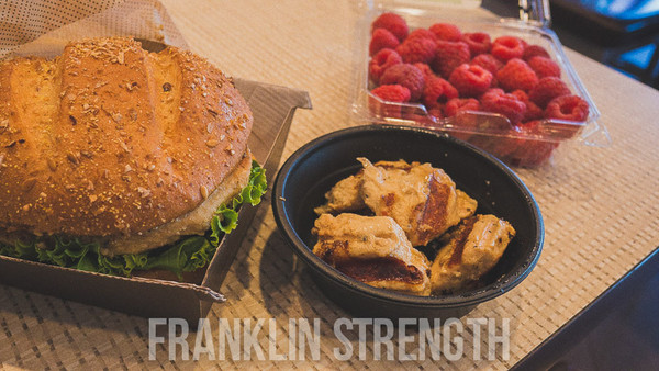 Chick-fil-a 1x Grilled Chicken Sandwich (no cheese) 1x 6 pcs Grilled Chicken Nuggets 120g of Raspberries (2 handfuls or 1 cup)  Calories = 484 Fat = 8.7g Sat. Fat = 3g Cholesterol =120mg Sodium = 1201.2mg Carbs = 57.4g Fiber = 10.2g Sugar = 13.3g Protein = 48.4g   TASTE = 4.5 CONVENIENCE = 3.5(IF IN DIRVE THROUGH) 5(IF INSIDE) SATISFACTION = 4.5 PRICE = 3.5 ($7.57@CHICKFILA AND $2.50 FOR RASPBERRIES)  TOTAL = 4   First time for me and I must say... pretty damn impressed. Let's start at TASTE. For fast food? Pretty good. The bread was hearty and the meat was flavored good. Again, the meal was lacking in fiber so I brought some raspberries from home (yes I know they don't sell this there but it's easy to pack with me on the go). I was decently satisfied with the meal. I was full and felt ready to go. I actually had this meal an hour before my lift and had one of my better sessions. But the best is the service. They bring the food to you. I was also asked 3 times by 3 of the workers how my day was going. I kindly replied horribly but it's the fact that they asked me that counts. The bad is 2 things.... do not go through drive-thru, ever. Go inside for sure. The 2nd was the price. I mean damn you would have though I went to chipotle or something. People will go broke going to this place, seriously.