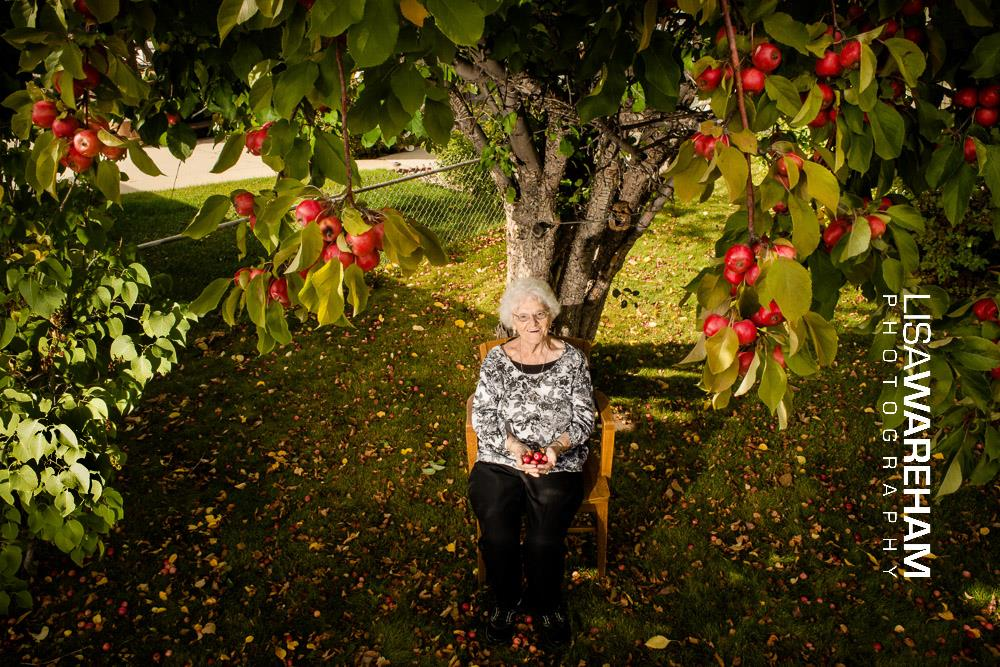 { Lovely Rose } When the mining industry was expanding in Butte and plowing down McQueen & Meaderville, she was plucking apple tree's, copper rose bushes, everything worth saving, and transplanting them around Butte.  Here she sits in her back yard on the flats, beneath the McQueen apple tree she planted in the soil with her own hands.