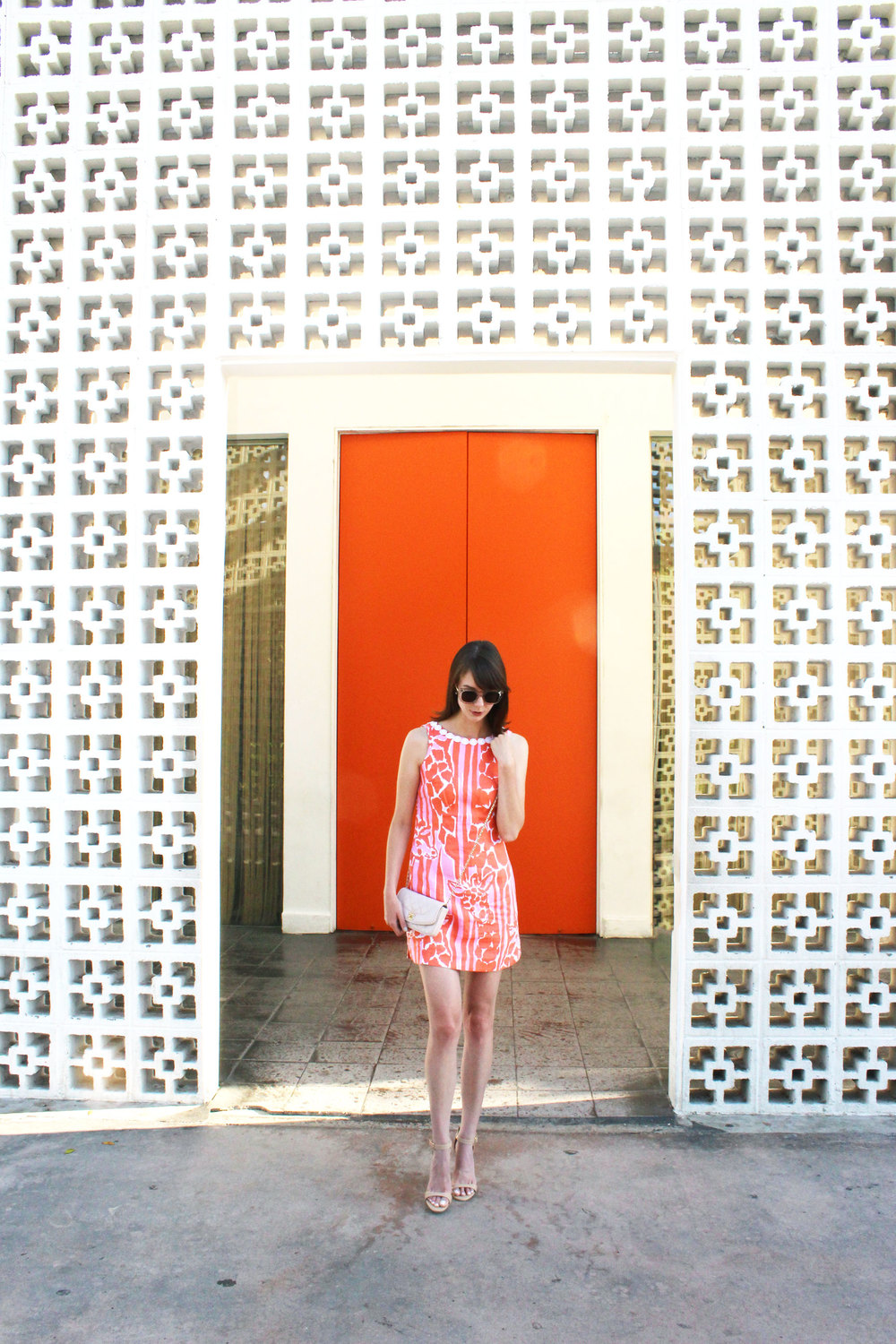 Orange you glad? Wearing the loveliest Lilly for Target giraffe print shift dress and a blush pink Chanel bag.