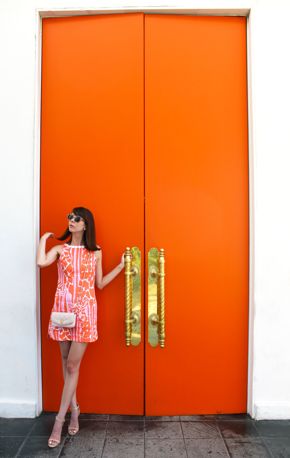 Orange you glad? Wearing the loveliest Lilly for Target giraffe print shift dress and a matching blush Chanel bag.