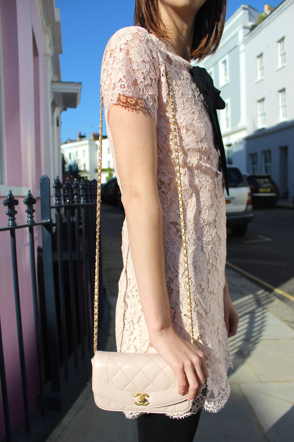 Pink lace dress and blush pink quilted Chanel bag