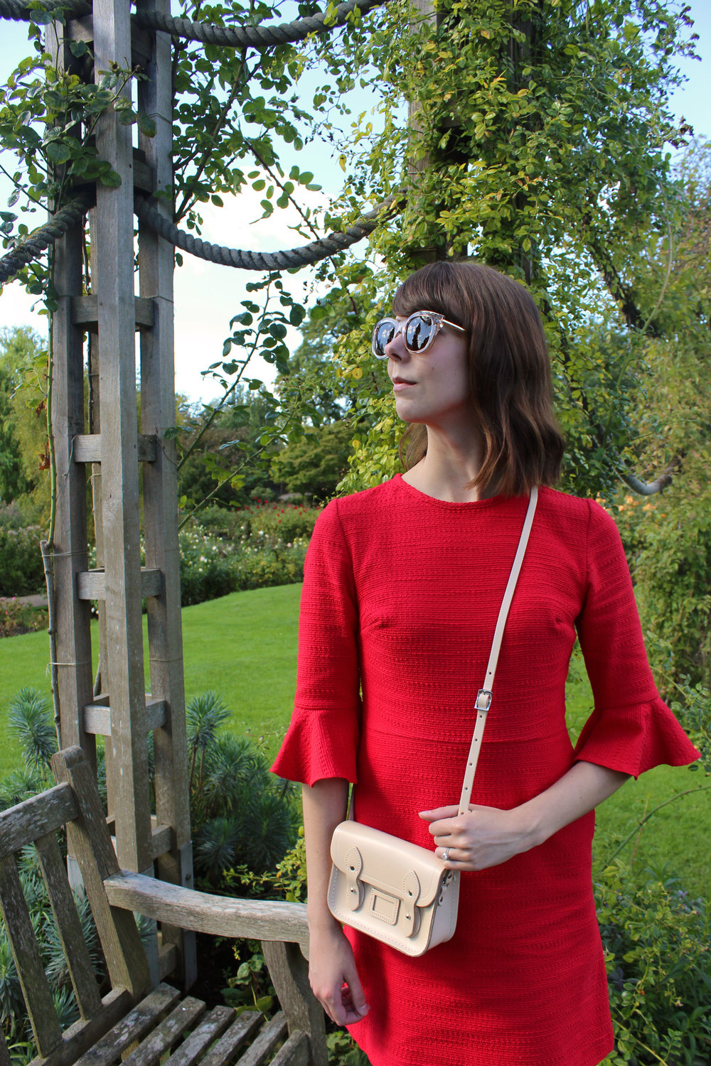 An afternoon in the rose garden at Regent's Park wearing a red dress and neutral accessories.