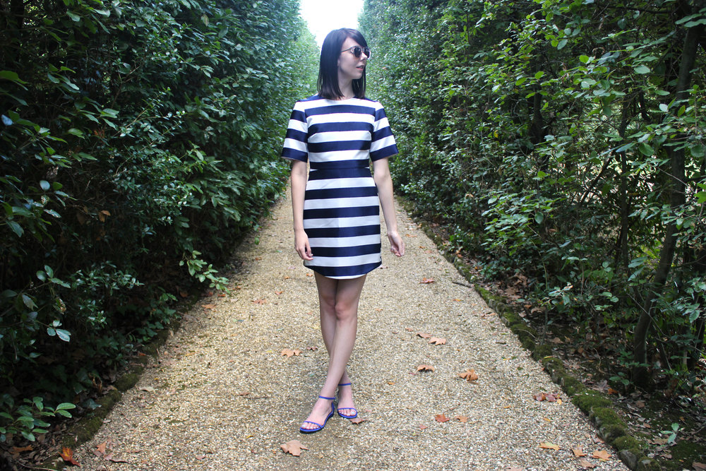 Wearing a striped Topshop dress and M.Gemi shoes at the Boboli Gardens in Florence.