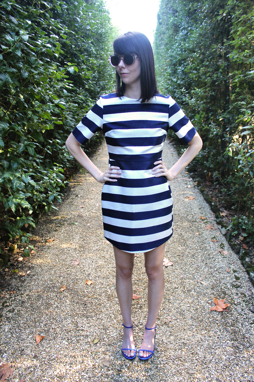 Wearing a striped Topshop shift dress and M.Gemi shoes at the Boboli Gardens in Florence.