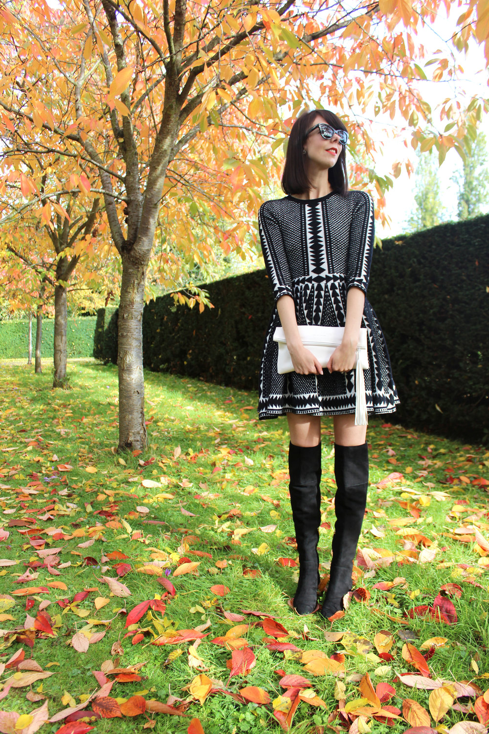 Suede over the knee boots and a cozy black and white sweater dress.