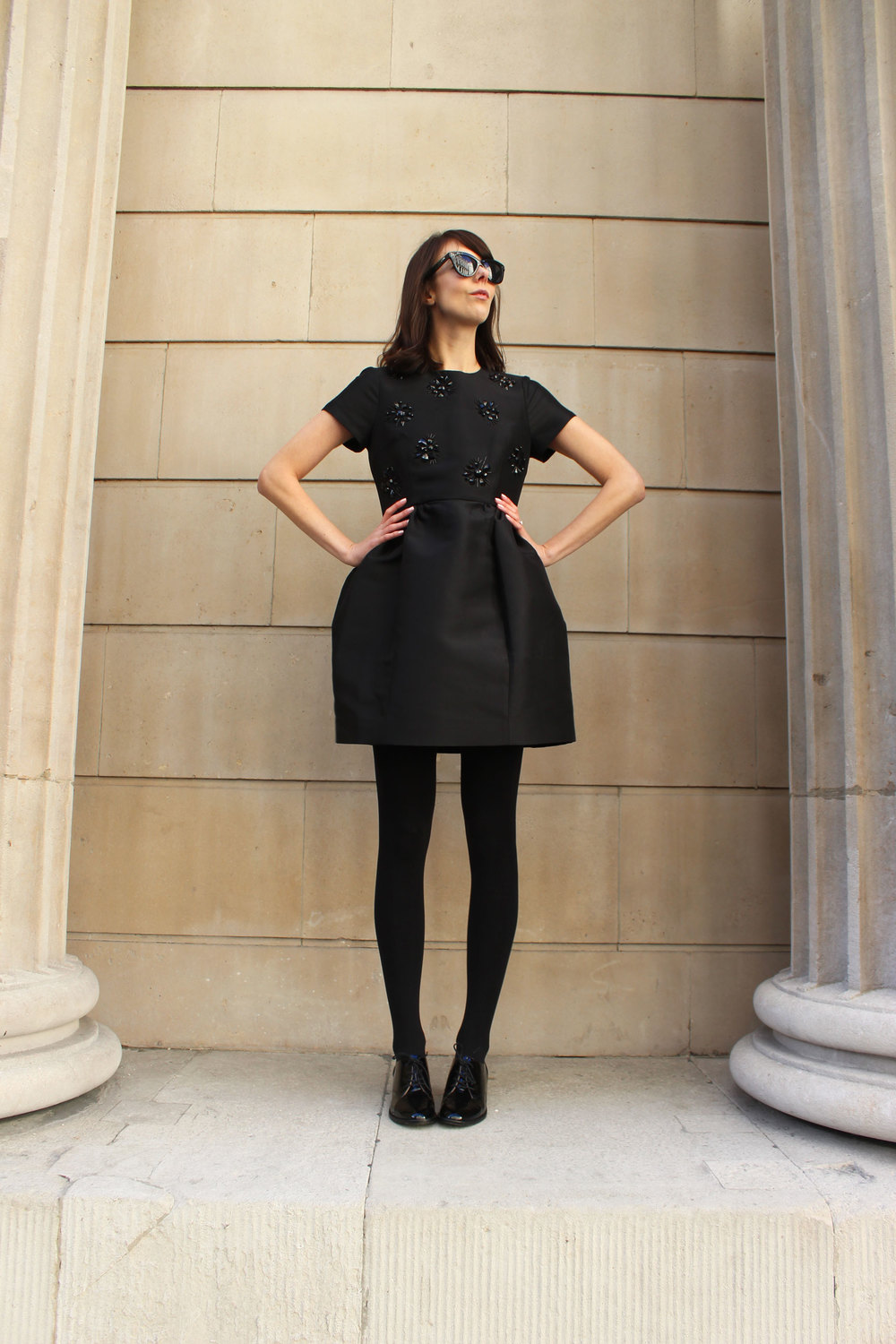Pairing a LBD with opaque tights and patent flats.