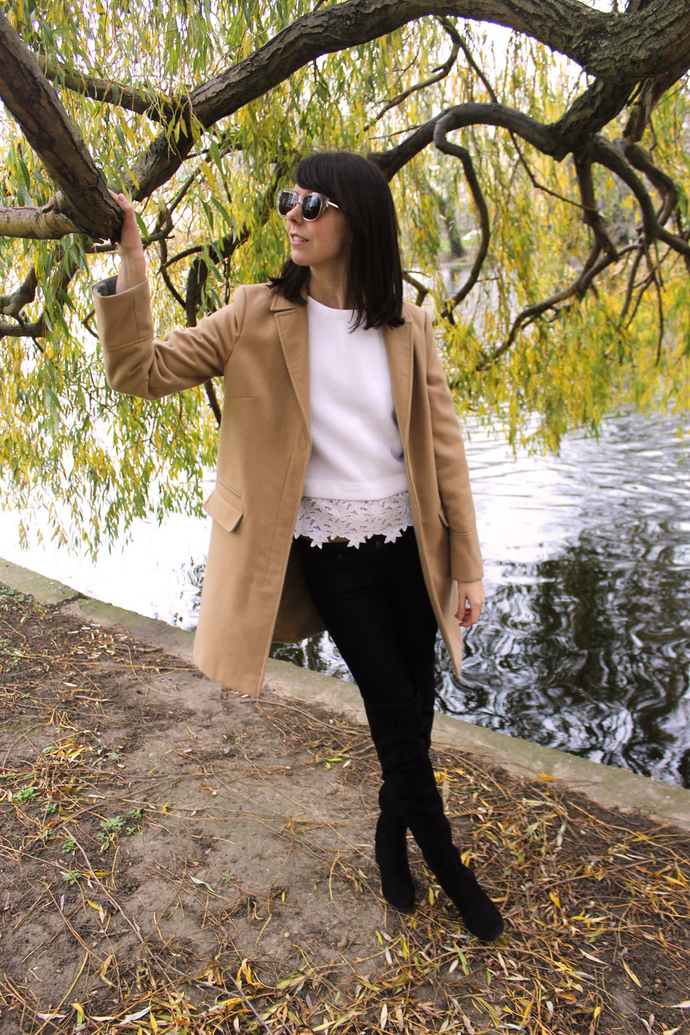 Camel coat paired with suede over the knee boots for fall and winter.