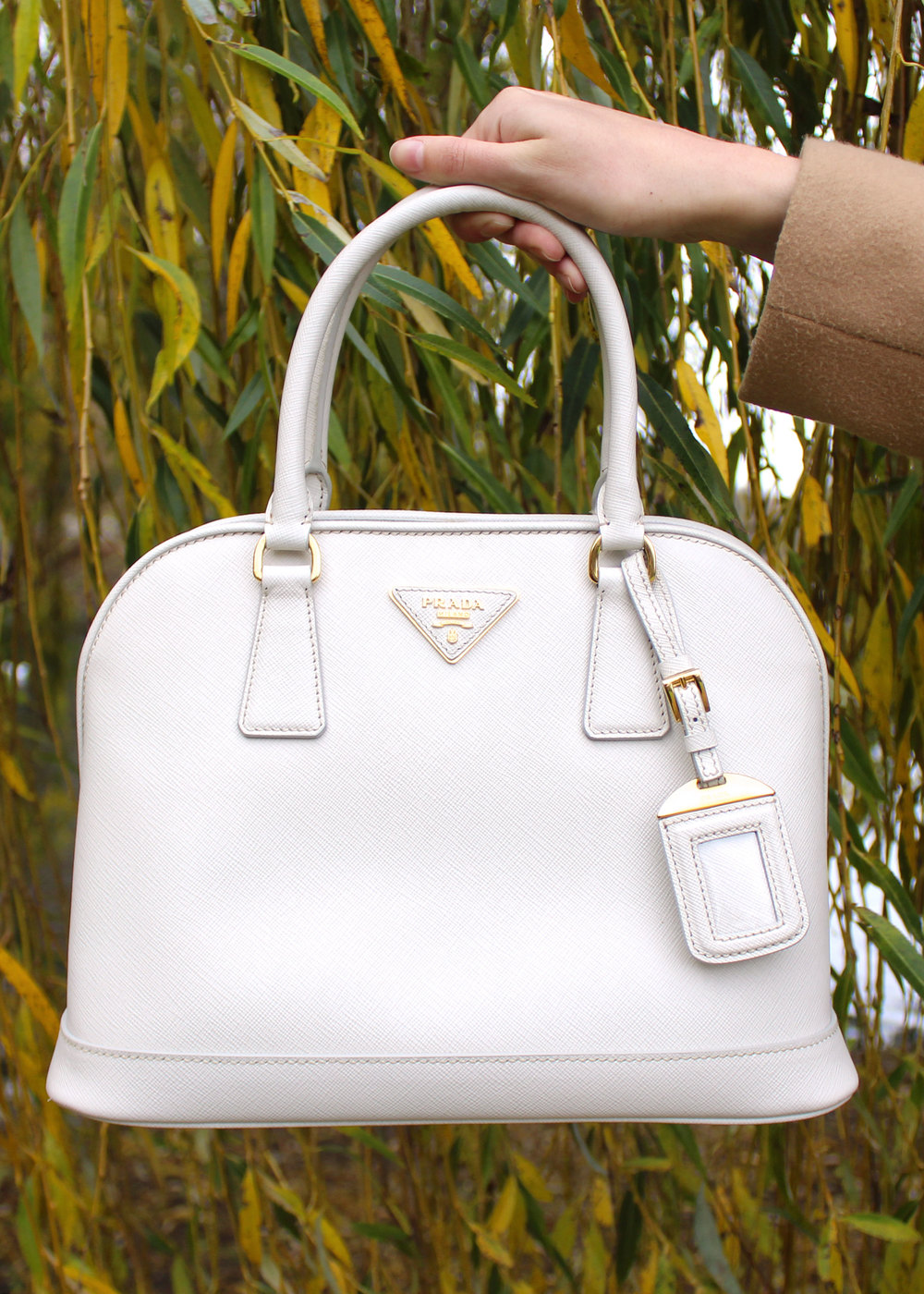 White Prada saffiano leather bag.