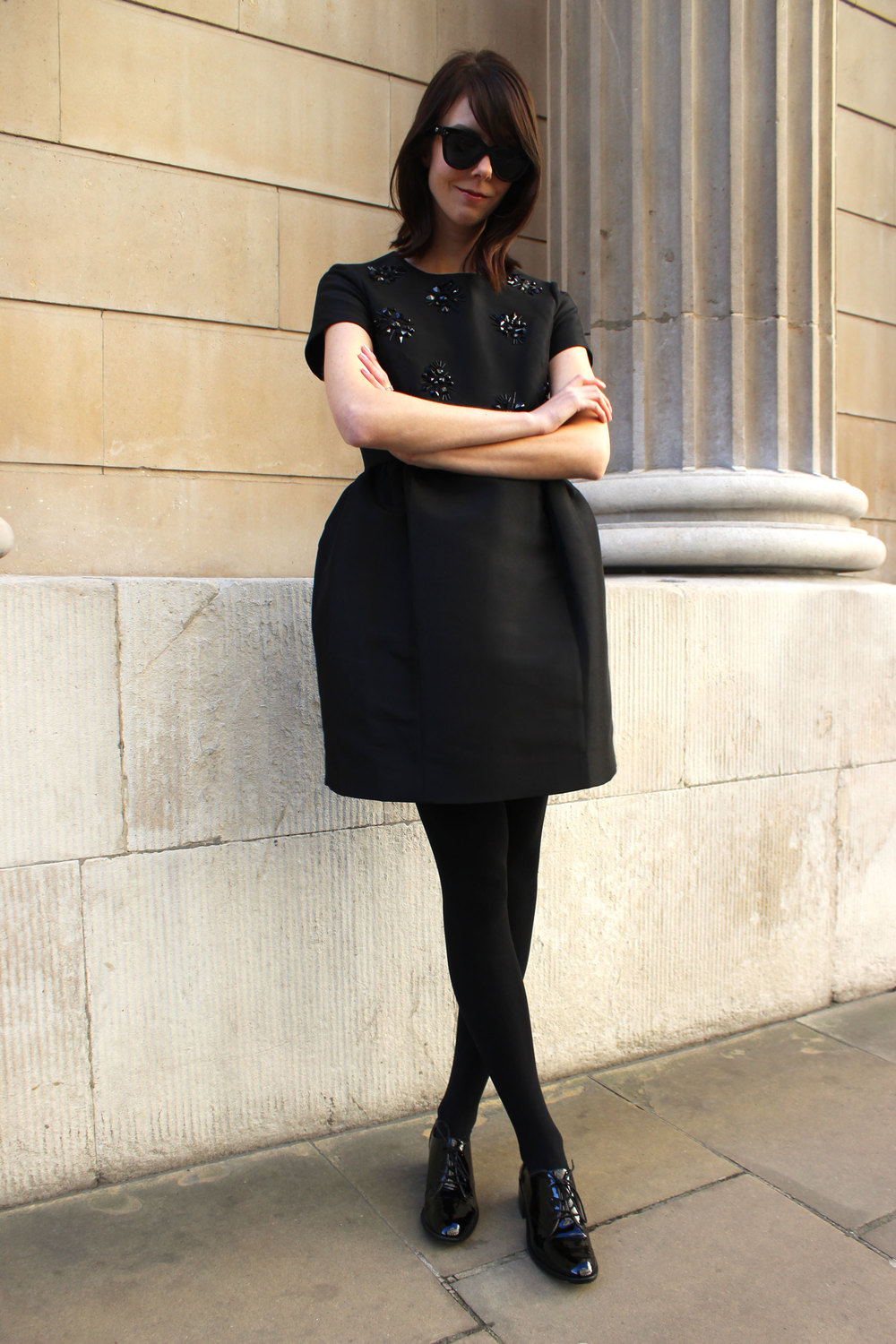 Ready for the holidays in a sparkly little black dress from Kate Spade paired with patent loafers.