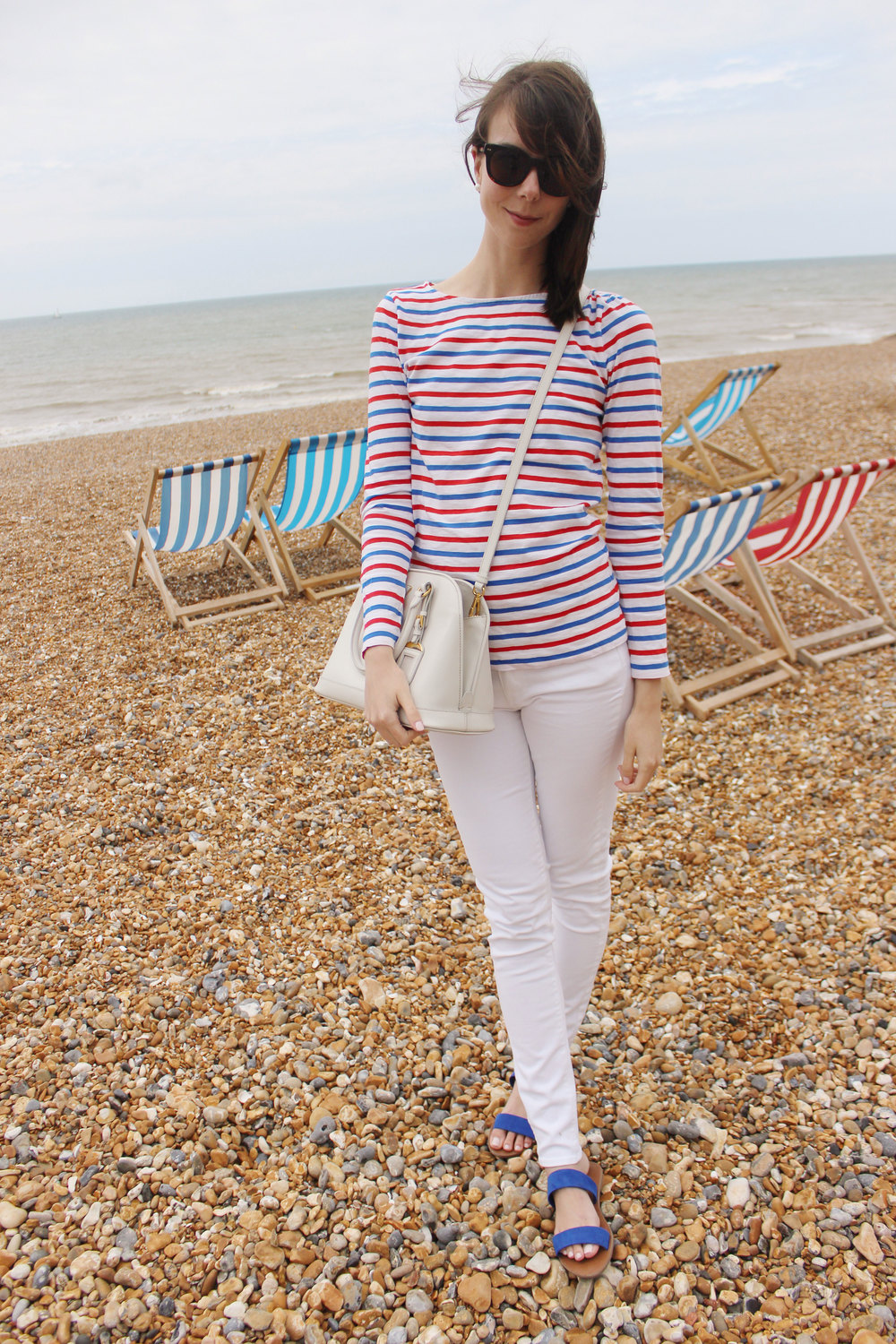 Braving the wind in brighton, wearing white red, white and blue.