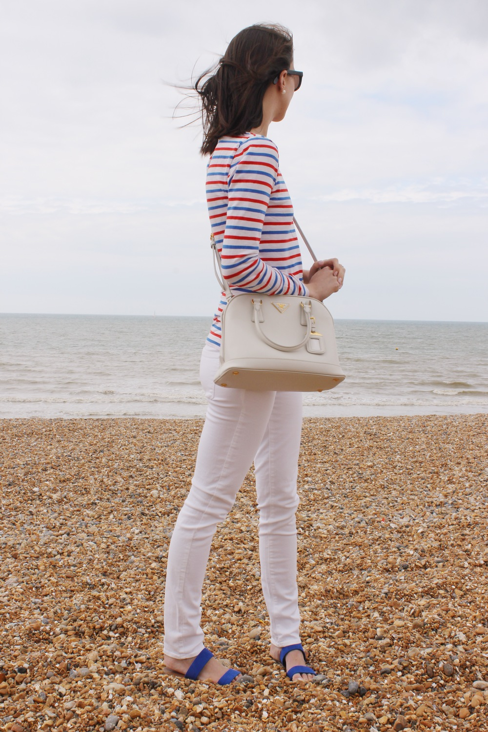 Admiring the views at Brighton Beach wearing red, white and blue.
