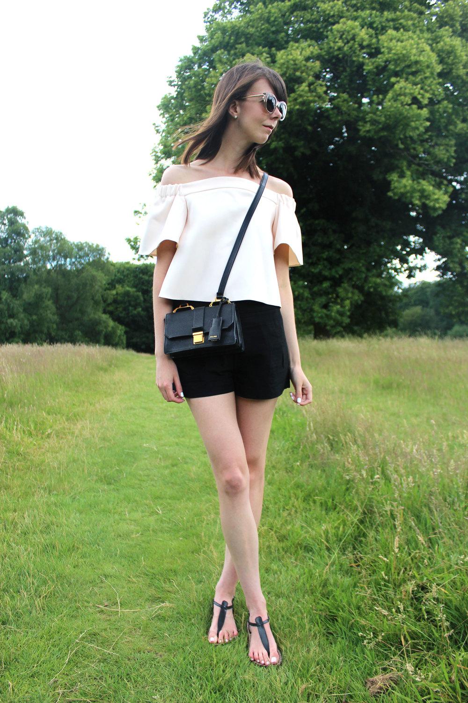 Hampstead Heath, London wearing an off the shoulder top and miu miu bag.