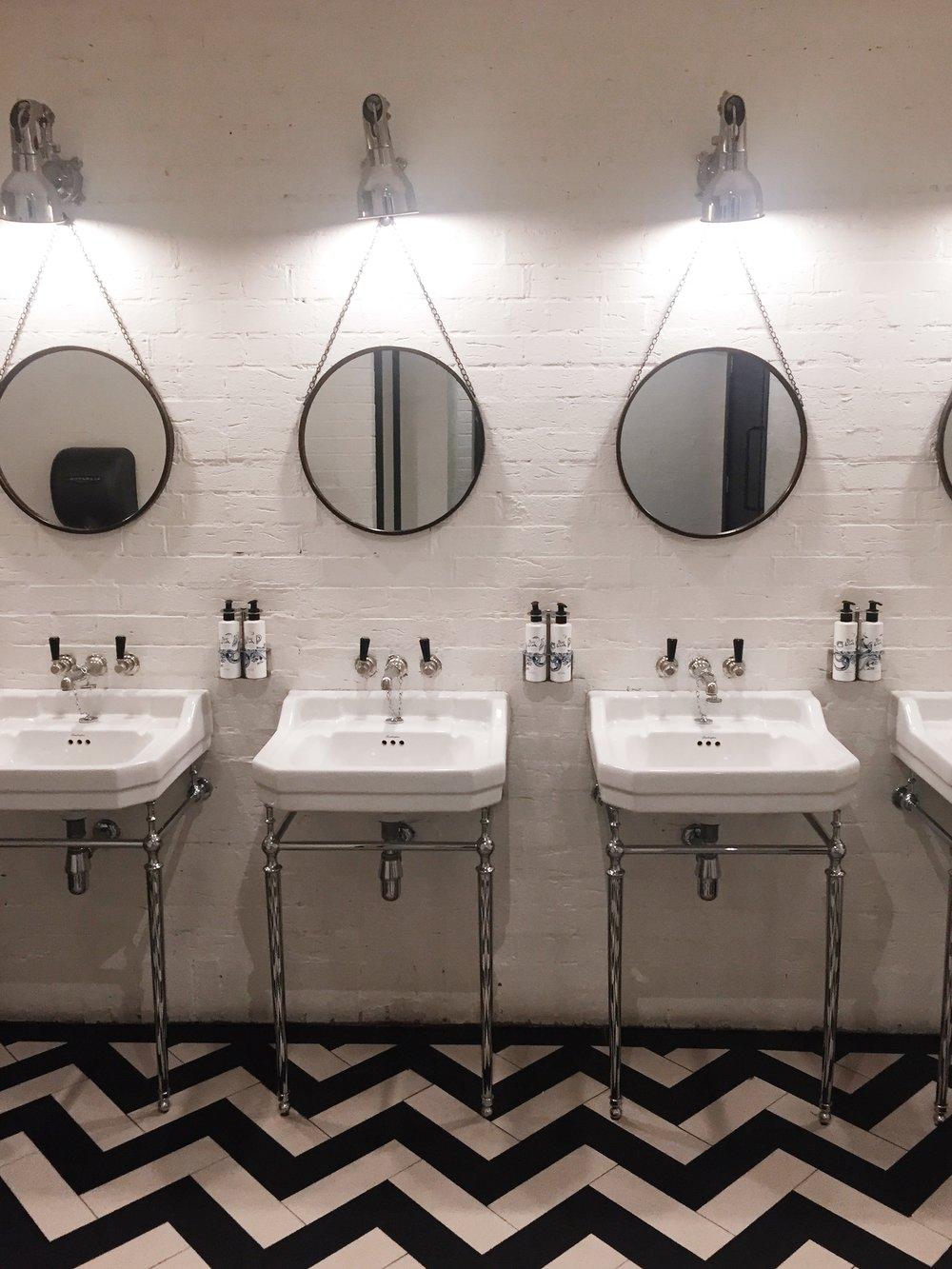 The Hoxton Hotel, Holborn London - chevron tile floors in the bathroom.