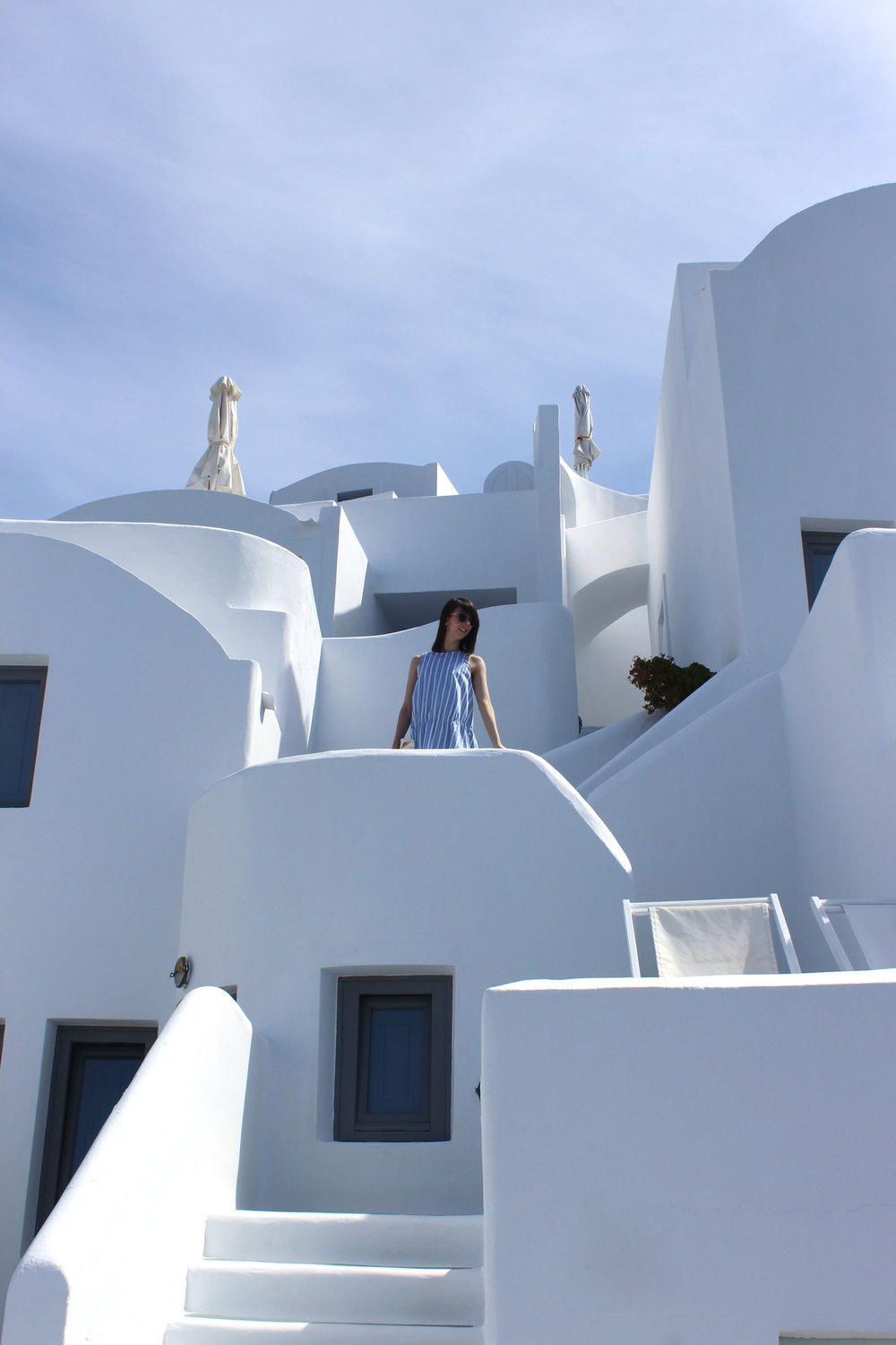 Standing amongst the whitewashed buildings in Santorini.