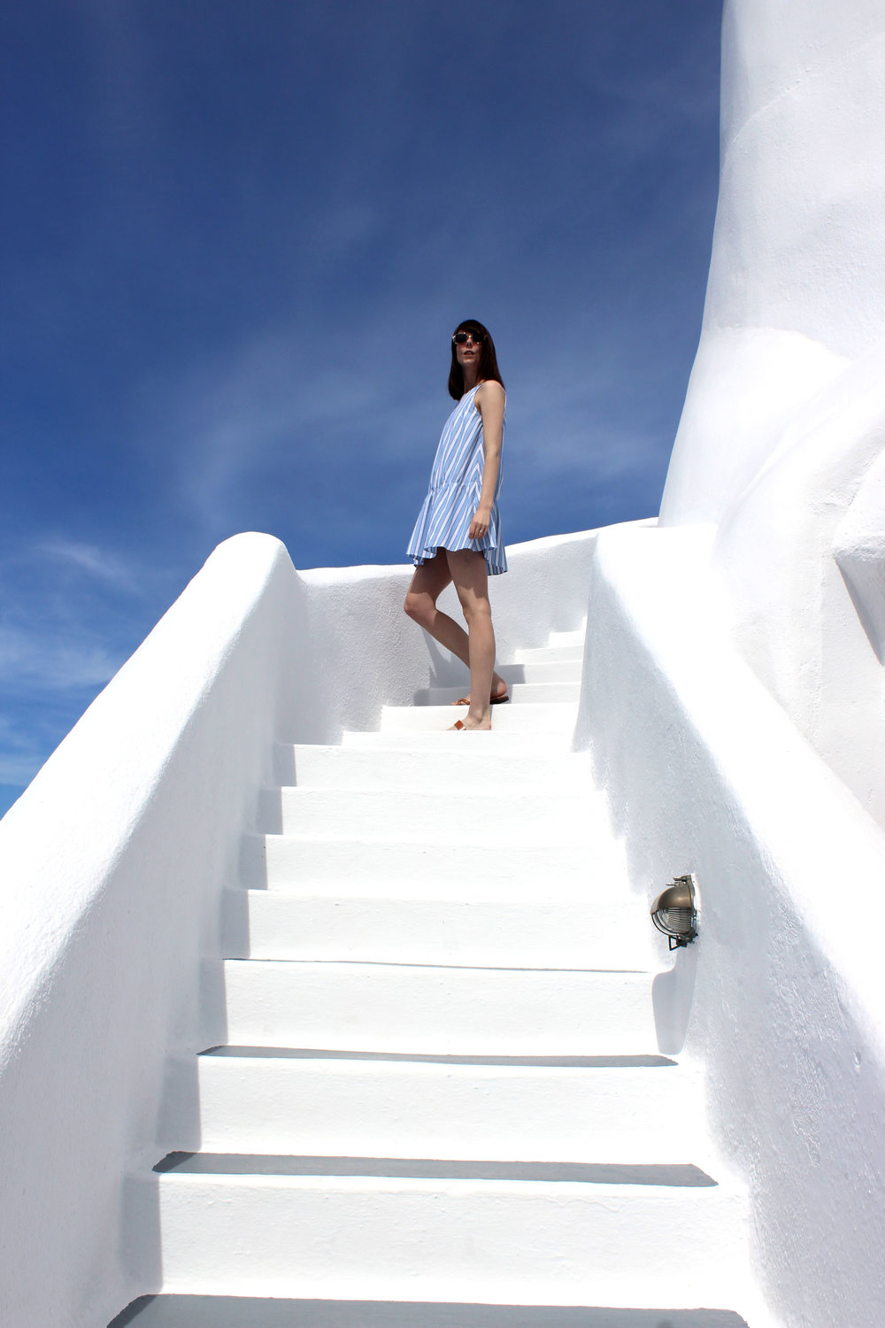 Blue skies and whitewashed walls at Ikies Hotel in Santorini, Greece.